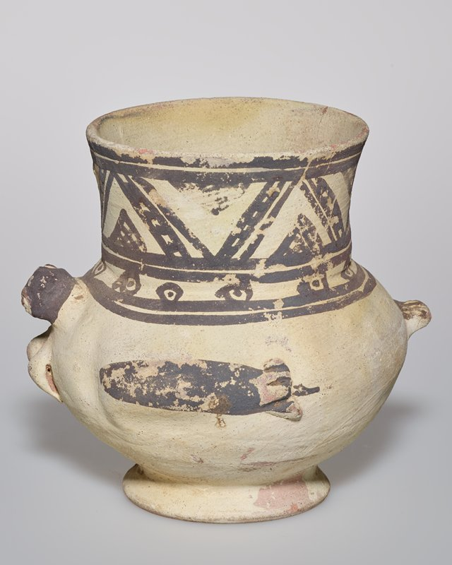 round vase with geometric band and with bird head, feet and fish protruding around sides; grey and white pottery
