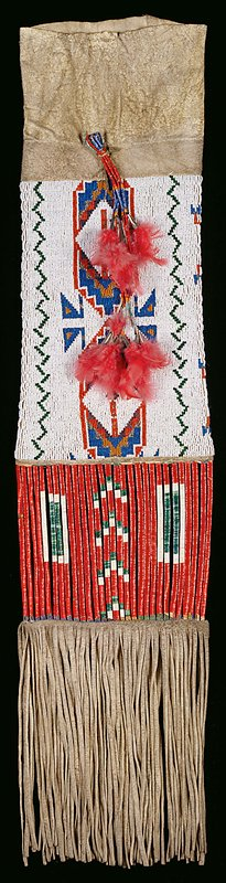 applique beadwork on the leather pouch; lower portion, bands of wrapped porcupine quill work; hanging ornament of quills and feathers at closure; length 27 inches, width 8.25 inches (exclusive of fringe).