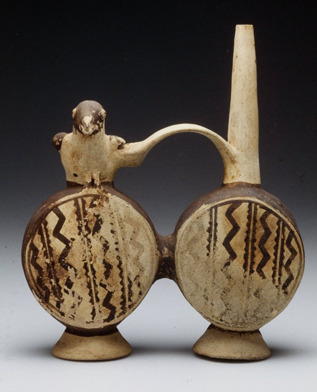 one of a pair of whistling huacos, each consisting of two round pots joined by a convex handle, one side decorated with a dove and the other containg a spout; pottery