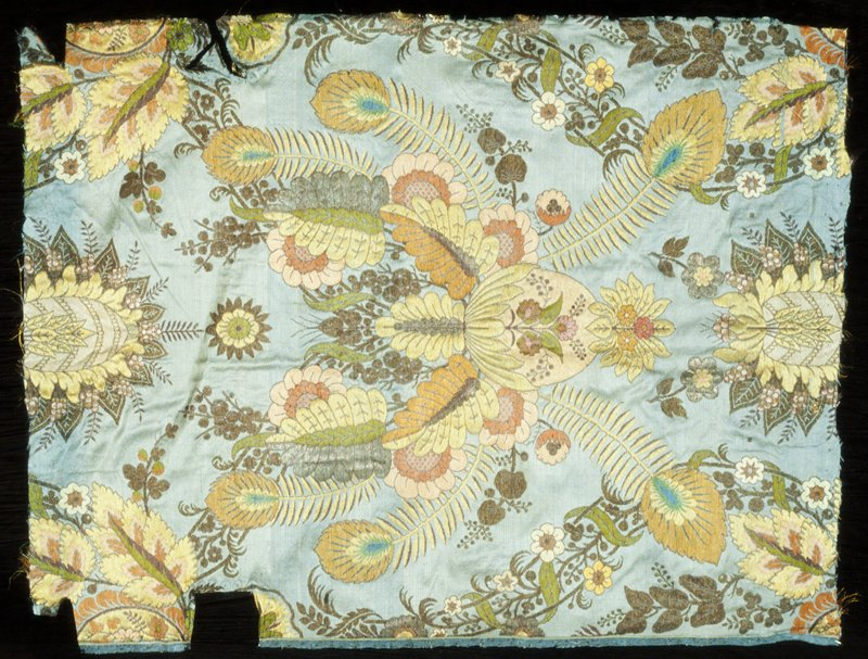 from a chair back upholstery; floral design with peacock feathers in peach, reds, green on gray-blue ground; patterned silk
