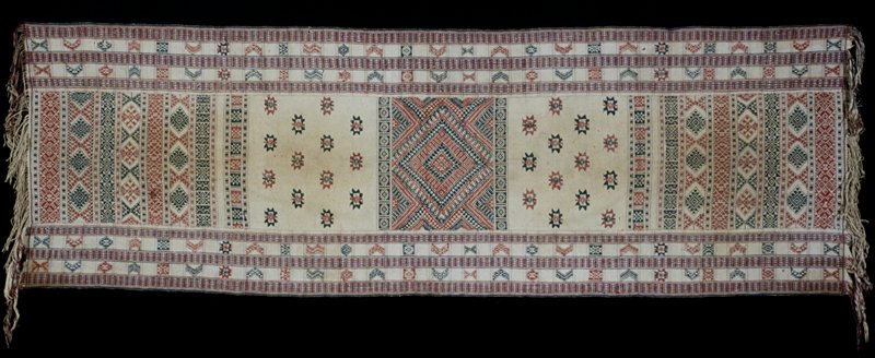 Chaksay Pankhep (lap cover), royal/religious lap cover; silk/cotton brocade on cotton background; red and blue supplementary warp and discontinuouos supplementary weft patterns on neutral ground