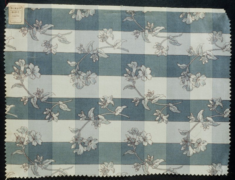floral pattern on checked pattern, blue, gray, and white predominating