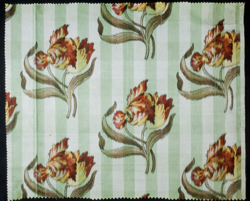 repeated single red and yellow flower on green and white checkered background