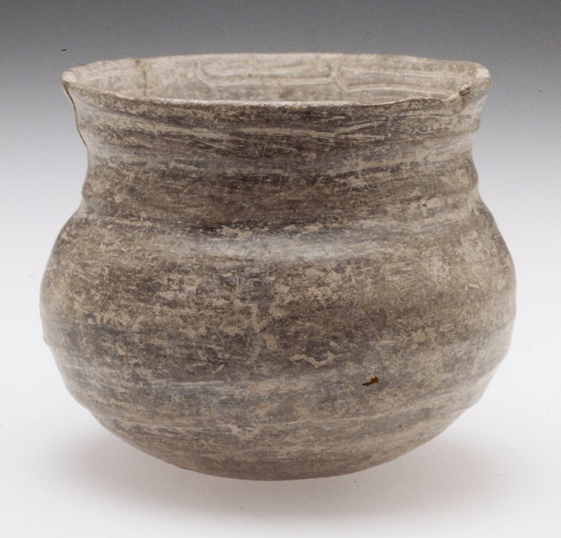 globular bowl with open flare top; buff earthenware with burnished gray slip