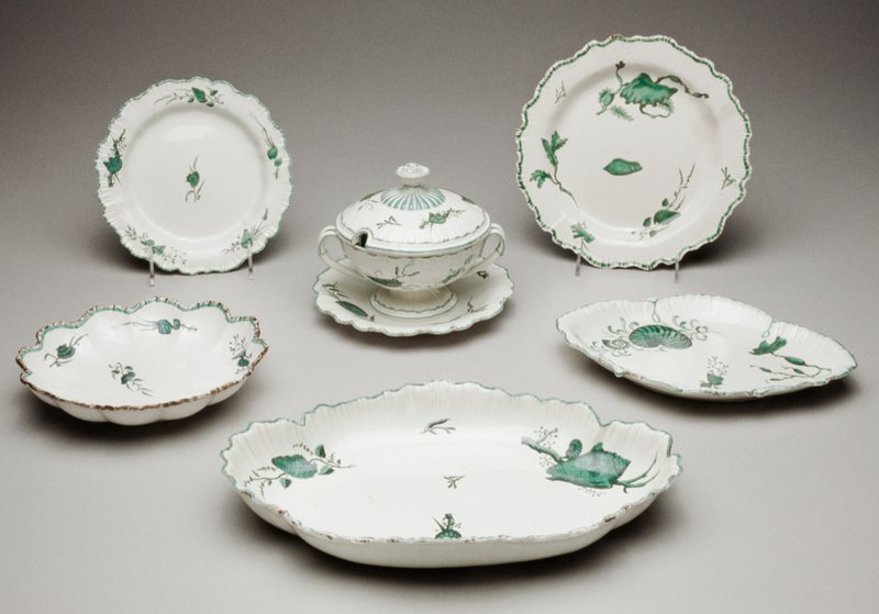 Wedgwood pearlware partial dessert service, porcelain, printed and colored in green with designs of shells and seaweed, includes thirty-three pieces .1-12 twelve side plates, di.7-1/2 in.; .13-14abc two sauce tureens with lids and saucers, H.6-1/2 in.; .15-.22 eight dessert plates, di.8-3/4 in.; .23-26 four lozenge-shaped dishes, L.9-15/16 x W.7-1/2 in.; .27-29 three circular dishes, lobed, di.7-15/16 in.; .30-31 two circular dishes,lobed, di.8-1/2 in.; .32-33 two quatrefoil dishes, L.12-3/4 x W.8-3/4 in.