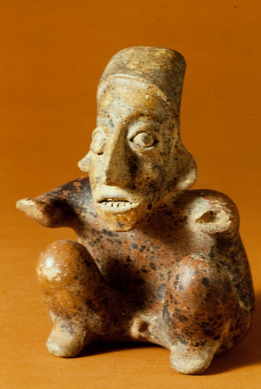 seated male figure, clay, red pigments, black spots, West Mexican (Jalisco), 200BC - 400AD