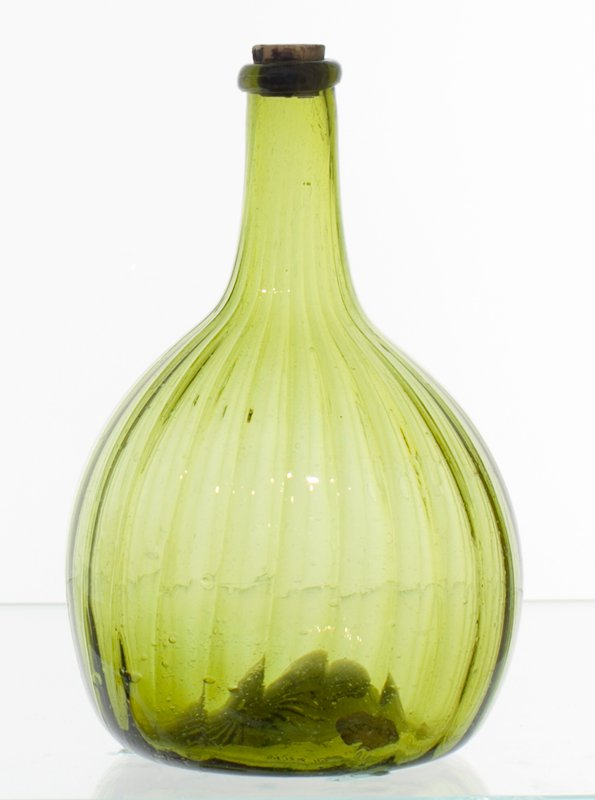 globular bottle, citron glass, 24 vertical ribs (melon ribbed); very pitted surface with outside of one bubble missing, attributed to Zanesville; bottle and dishes from Ohio Manufacturers, 159 items in all, from the Walter Douglas Collection in Centerville, Ohio