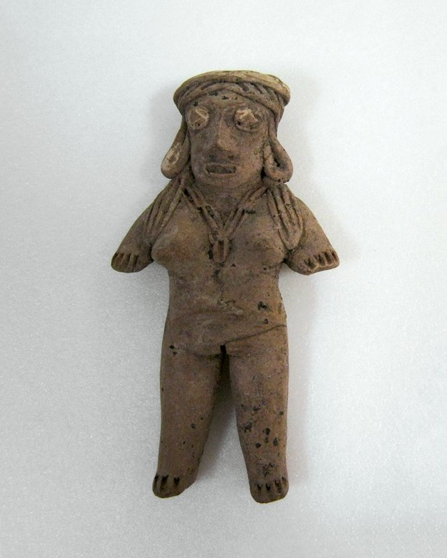 Standing Female Figure with diamond eyes, incised hair shoulder length and looped on sides, slash fingers and toes. Buff clay with white on hairband and hairloops. Mexican (Michoacan), 200-600AD