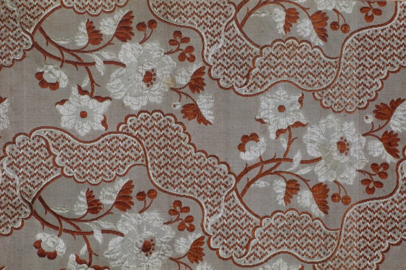 silk, gray, orange and white floral and meandering lace patterns