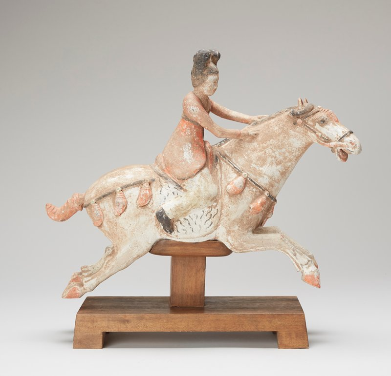 terra cotta with traces of pigments. Wood stand shaped to support horse.