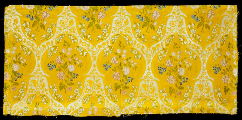 Two lengths of silk stitched together along selvedge. Yellow silk with large white ogival meanders, polychrome flowers.