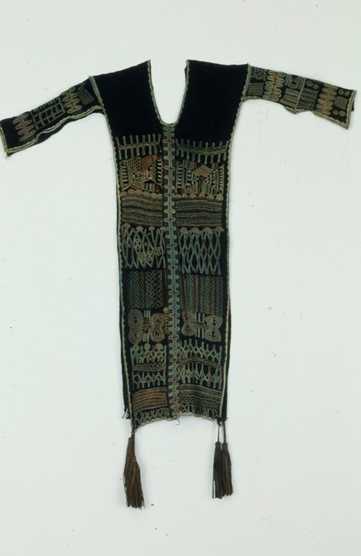 neck garment, cotton, leather, embroidery, African (Mali-Fulani) XXc stored in box; (Simmons); dims 35 x 11-1/2'; stored w/86.100.22,.30,.34,.35 blue cotton, stripwoven, four leather tassels at lower corners, embroidered in red, green, yellow, blue and white