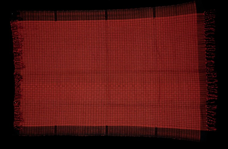 Black and red basket pattern center with black warp borders, each of which have 3 open worked areas