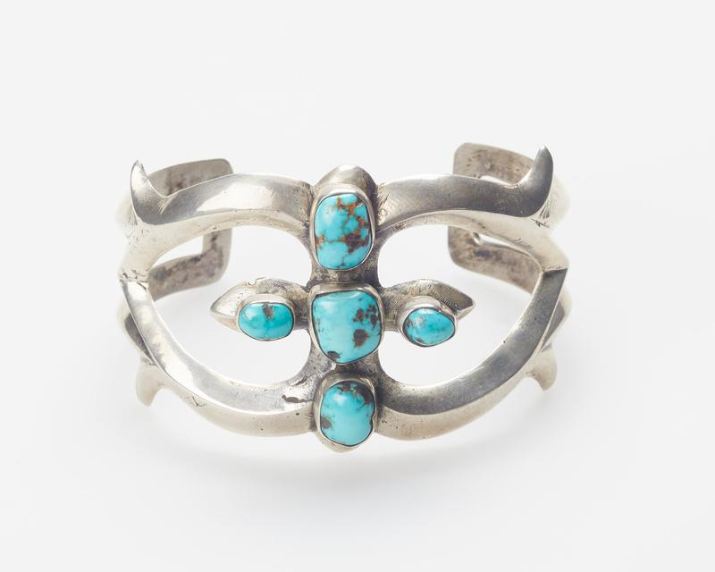 cast openwork silver band; set with 5 Morenci turquoises of irregular shape; J.#316, Cat.#326