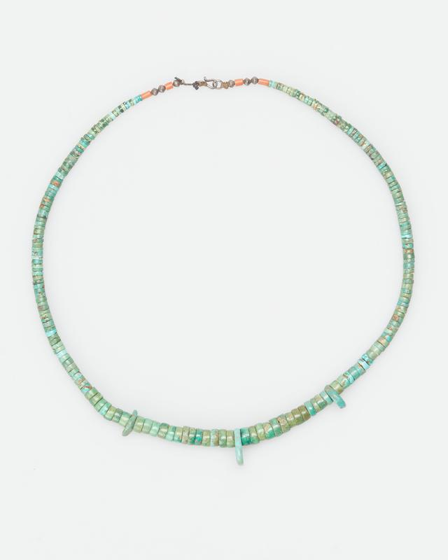 single strand of graduated turquoise; 6 silver beads and 4 coral; 3 large pieces turquoise. J.#258, Cat.# 889