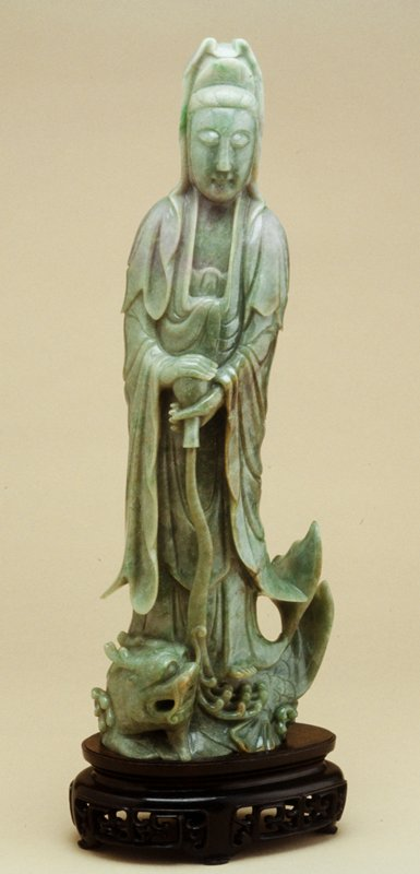 'Kwan Yin poring Flask of Water' (over curling ferocious carp with dragon beneath her feet), apple green jade with emerald green and lavender patches
