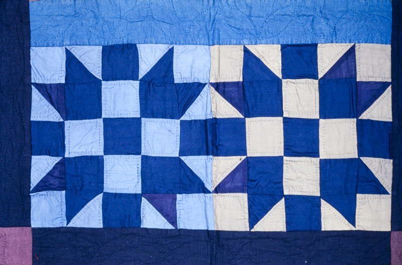 cable stitch and geometric quilting; star variation on nine patch square quilt pattern(four stars); blue tones