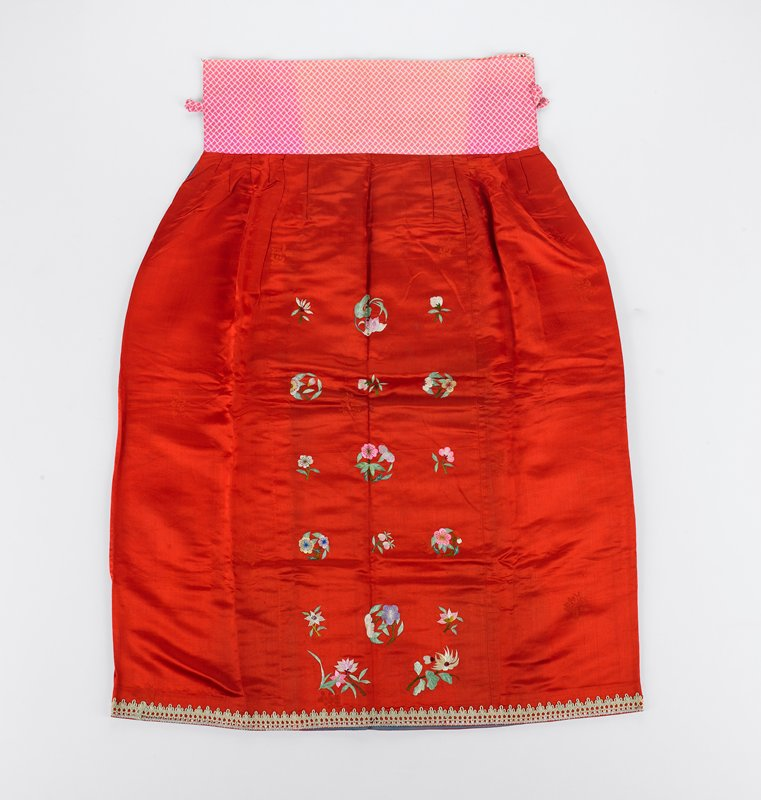 tabby ground silk damask with embroidered auspicious flower decor, attached cotton waistband and fringe applique
