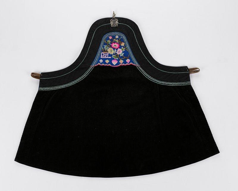 blue corduroy, blue cotton, embroidered panel, braid trim, metal fastener