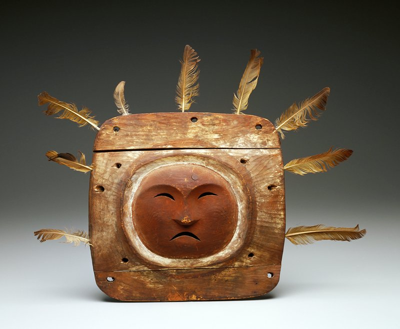 Mask, wood, painted, and feathers inserted in the outer edges; Inuit (Eskimo), Anvik From the Anvik area along the Yukon River.