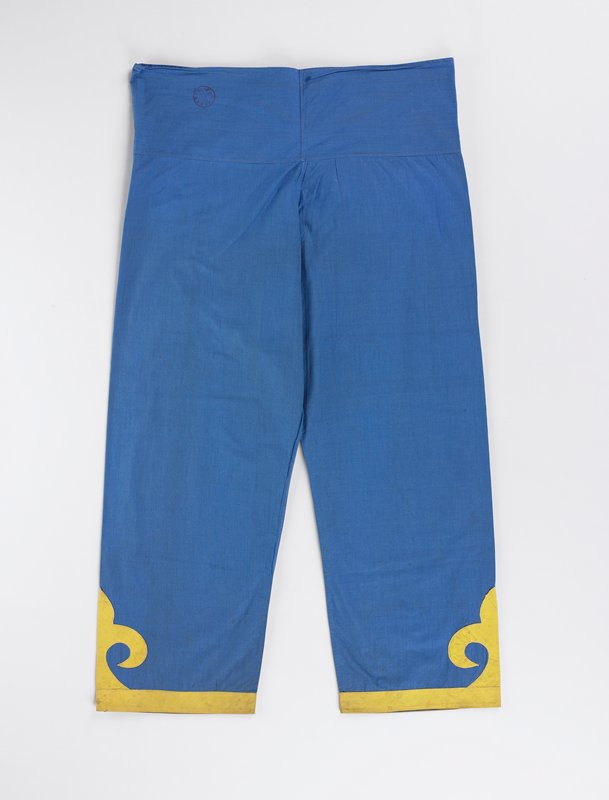 bright blue pants with gold cuffs