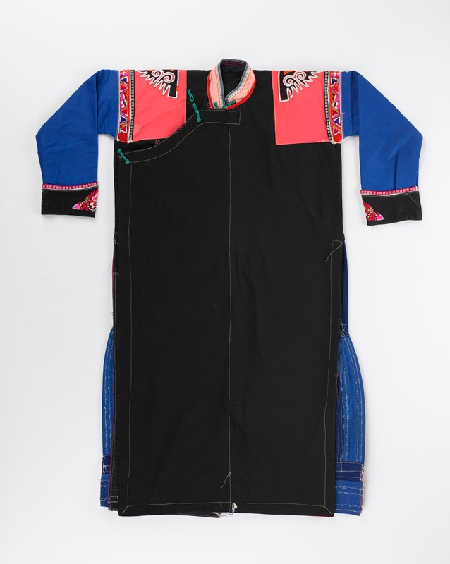 black body, pink shoulders, blue sleeves with black cuffs; bottom edges on back embroidered with six bands of geometric and floral designs; green ties neck and side