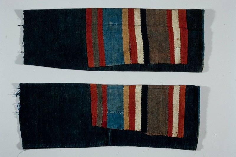 indigo cylinder with rectangle of twelve multicolored bands applied near finished cuff