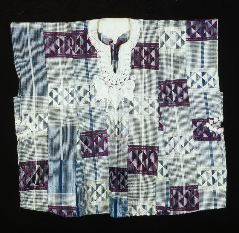 blue and white checks with rectangular areas of white and purple bands and triangular design; white spiral embroidery