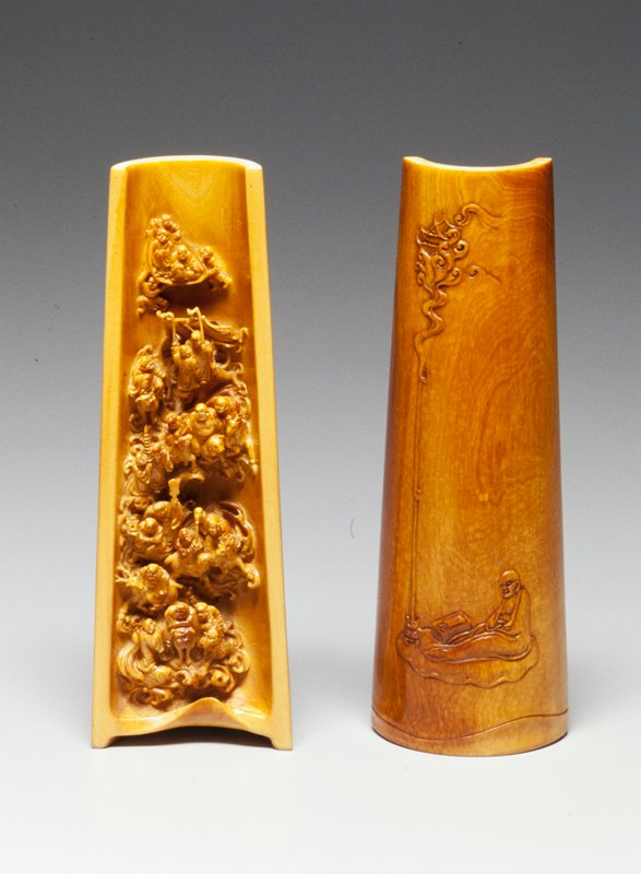 half cylinder; carved figures in concave portion; seated scholar depicted on outside; purchased with BBD funds by QI Xiyu