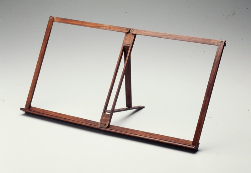 hinged members open to form a rachet supported bookstand, with five height settings
