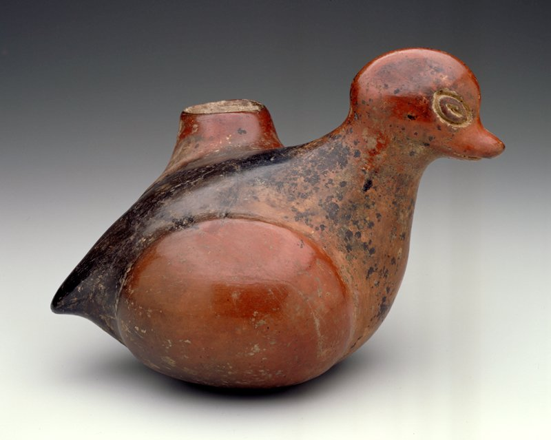 Bowl in form of a duck with side spout; buff clay with burnished red slip. Restoration on spout; H. 8 1/2 in.