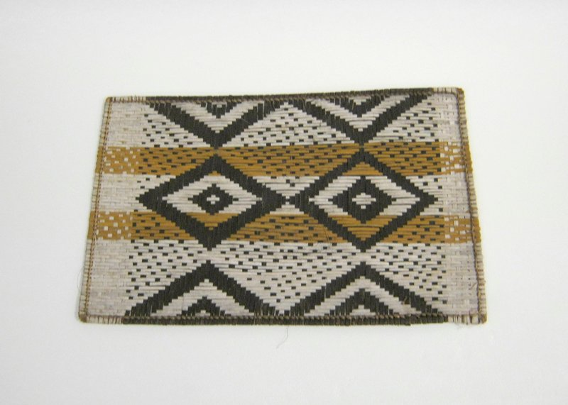 Small mat with geometric design in dark brown, light brown and light tan fibers; pair of diamonds with smaller diamond inside each at center; paired triangles above and below diamonds