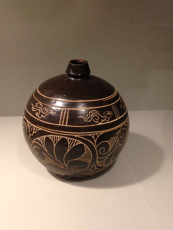 Cizhou; very short neck, flaring slightly inward; 3 bands of floral decorations and scrolls, incised in dark brown glaze; round body