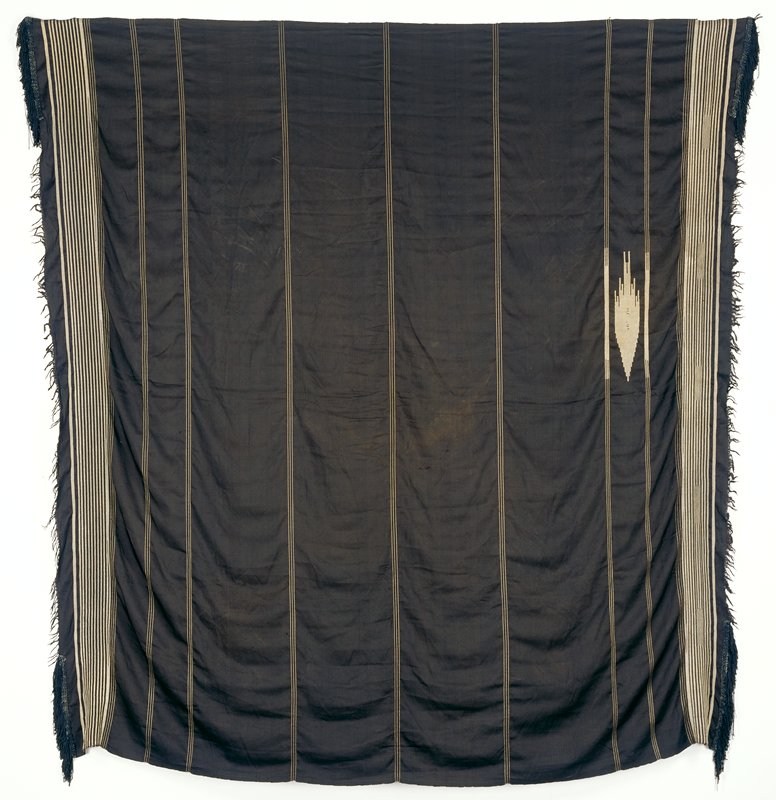 black ground with thin metallic stripes in groups of 3 and 5 in. striped border at 2 ends; fringe at 2 ends from warps with heavier silk fringe applied at 4 corners