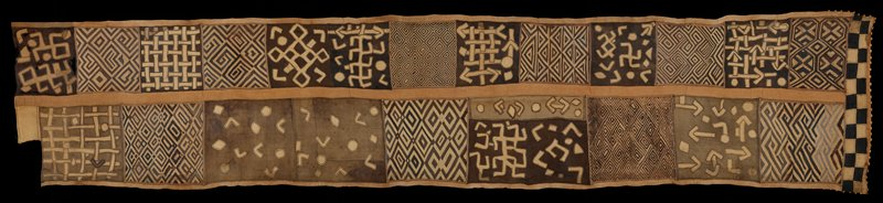 various sizes of raffia panels stitched together; applique and embroidery; various shades of brown