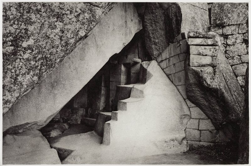 fragments of stone walls; step formations on rocks at center