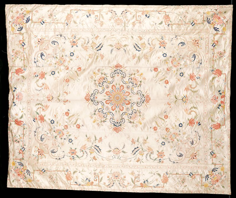three panels sewn together; silver field with floral and organic designs in blues, reds, greens, yellows and browns; large central geometric floral design with rectangular border 8 inches from the edge