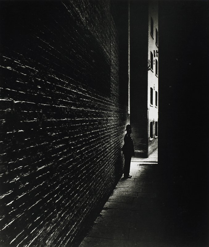 policeman in alley at night