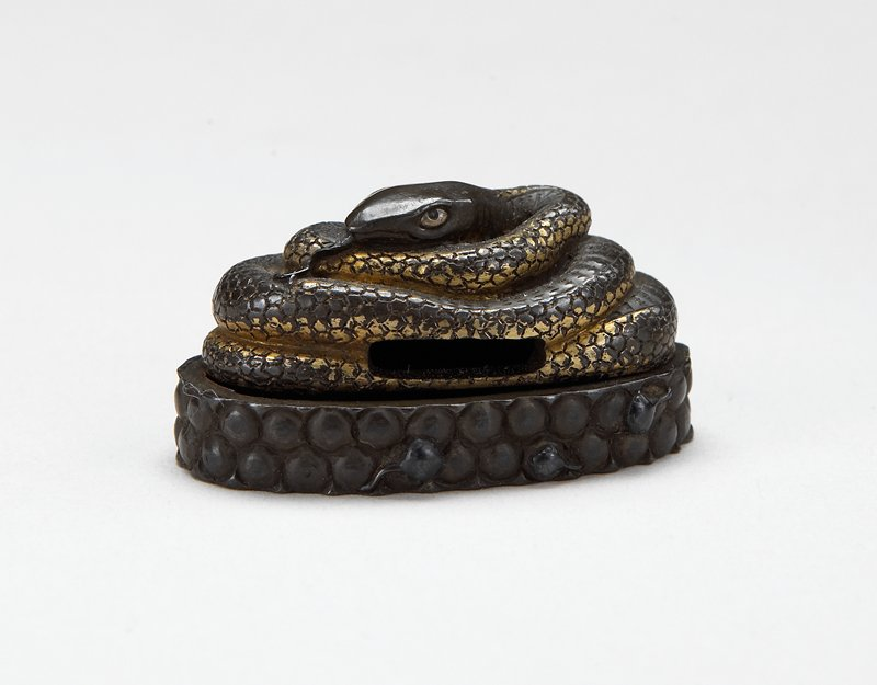 hilt, double row of bumps around circumference; final, gilt coiled snake with tongue out