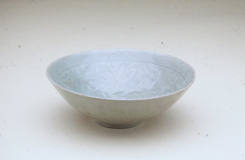 stoneware with celadon glaze, incised floral decor