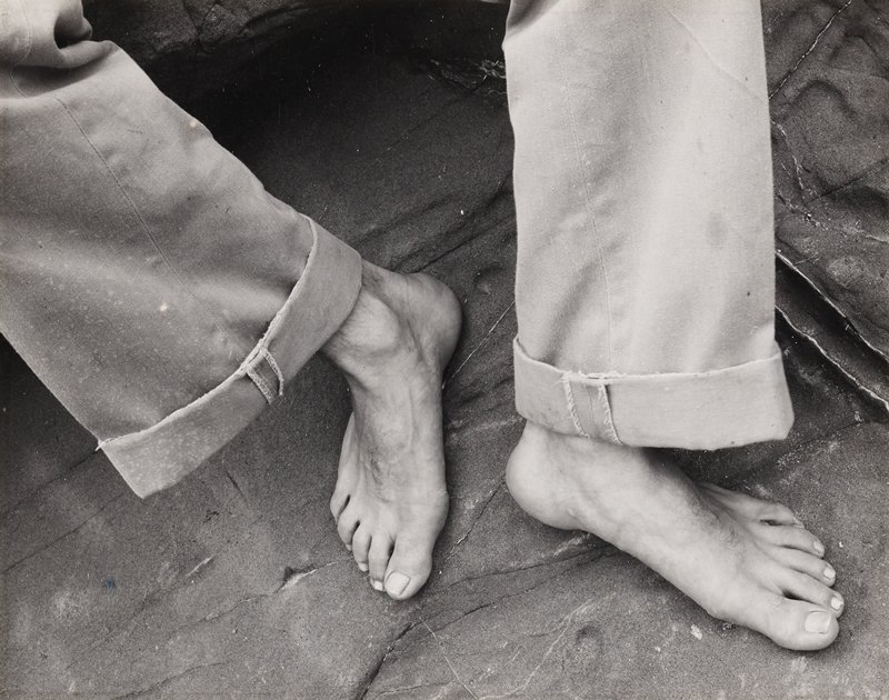 man's feet; man wears rolled-up pants