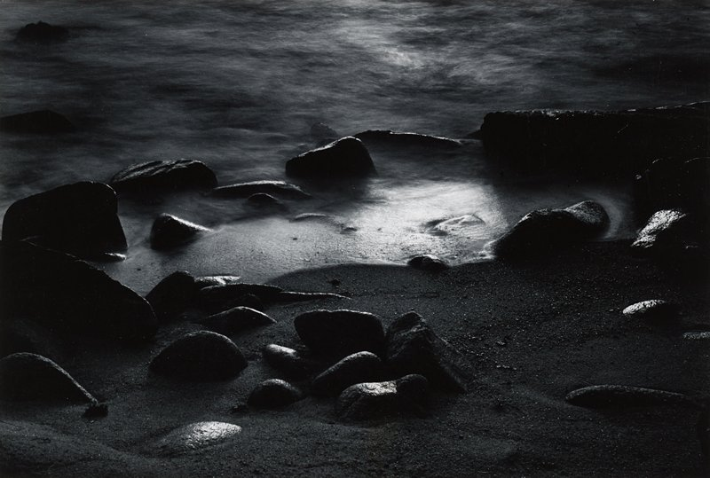 rocks and water on sandy beach