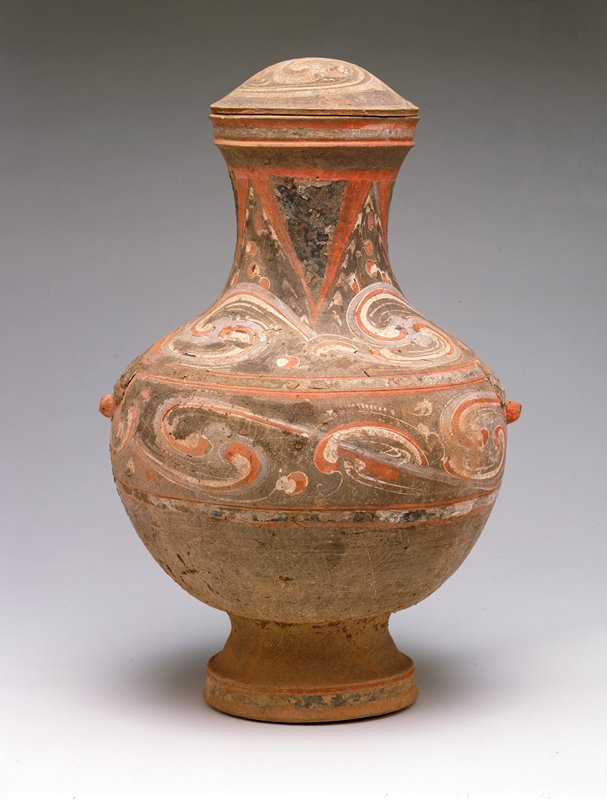 covered jar, grey earthenware; painted cloud pattern in red, white and purple slip