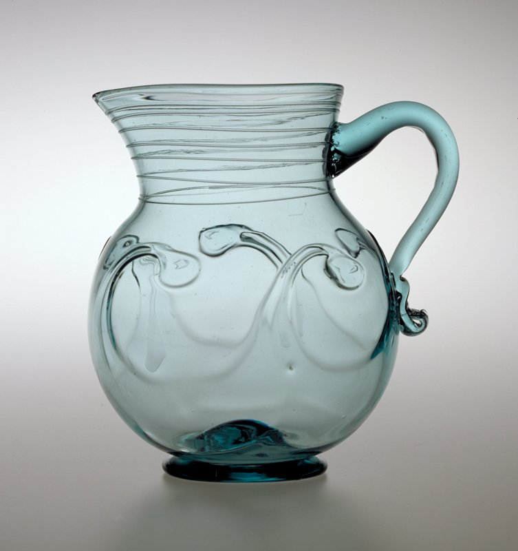 Redford Crown Glass Works near Plattsburgh NY or Redwood Glass Works, Alexandria, near Watertown NY, Monumental Aquamarine Freeblown Pitcher with Lily-Pad Decoration, between 1831-1850 glass, free-blown, with applied handle, foot, threading and lily-pad decoration.