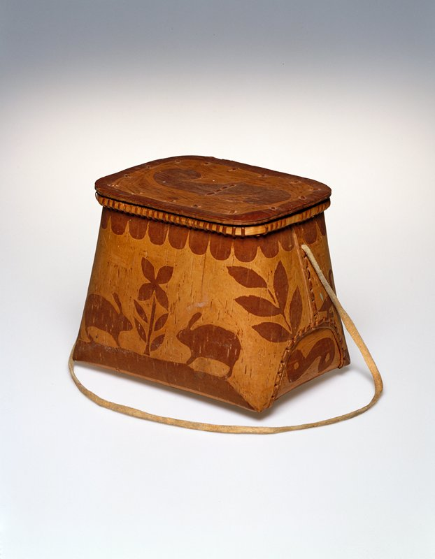 Birchbark basket with lid and leather handle. Darker design around rim of scalloped edge. Lower body of basket has animal and plant motif (beaver, birds and rabbits).