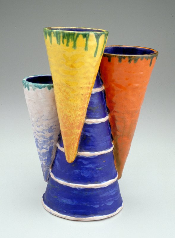 Four cone-shaped forms in blue and white stripe, orange, yellow and white with blue undercoat