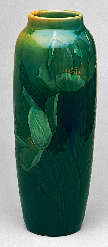 tall vase decorated with carved tulip motif and sea green glaze by Sturgis Lawrence for Rookwood