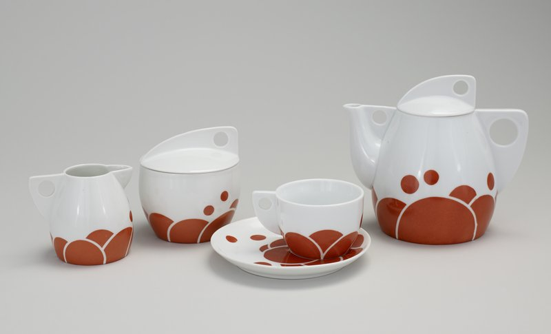 lidded teapot with red-orange circular and semi-circular decoration on white ground; part of tea service which includes cup and saucer(L99.227.7.2a,b), covered sugar bowl and creamer (L99.227.7.3-4), Norwest #88-28