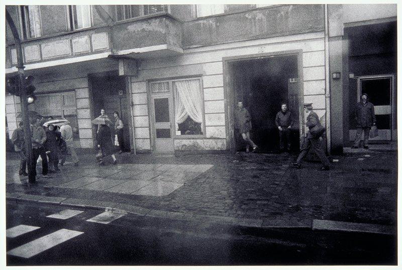 rainy sidewalk scene