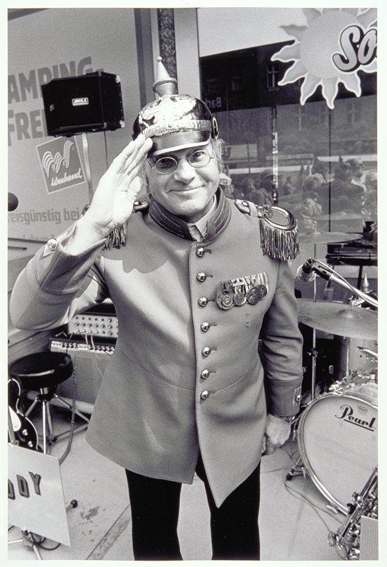 uniformed man saluting
